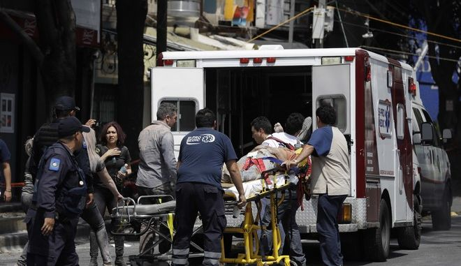An injured person is put in an ambulance in Mexico City, Tuesday, Sept. 19, 2017. A powerful earthquake jolted central Mexico on Tuesday, causing buildings to sway sickeningly in the capital on the anniversary of a 1985 quake that did major damage. (AP Photo/Rebecca Blackwell)