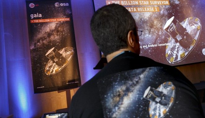 A scientist with a GAIA surveyor shirt attends the event of the European Space Agency, or ESA, to release the first data on its GAIA mission to make a Space map, at the ESA center in Villanueva de la Canada, near Madrid, Spain, Wednesday, Sept. 14, 2016. The European Space Agency said Wednesday its mission to chart more than 1 billion stars in the Milky Way is on track for completion in a year's time. The agency released the first data from its ongoing effort, called the Gaia Mission, to draw the biggest and most precise three-dimensional map of our galaxy. (AP Photo/Daniel Ochoa de Olza)