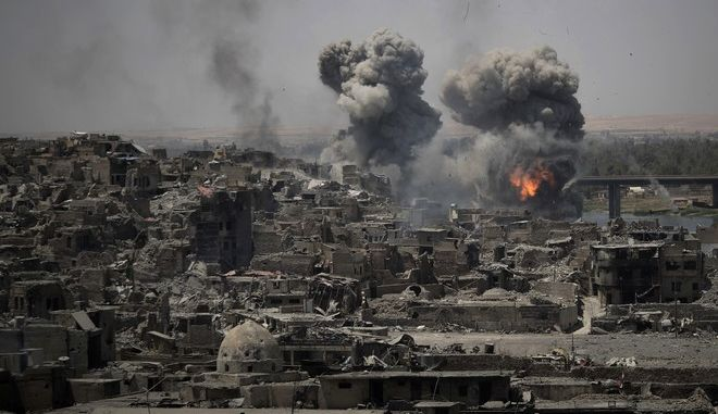 "In this July 11, 2017 photo, airstrikes target Islamic State positions on the edge of the Old City a day after Iraq's prime minister declared ""total victory"" in Mosul, Iraq.  The U.S. military declassifies 81 locations of unexploded, coalition bombs dropped in Mosul in new effort to help aid groups and contractors clear explosives from Iraq's war-scarred cities.  (AP Photo/Felipe Dana)"