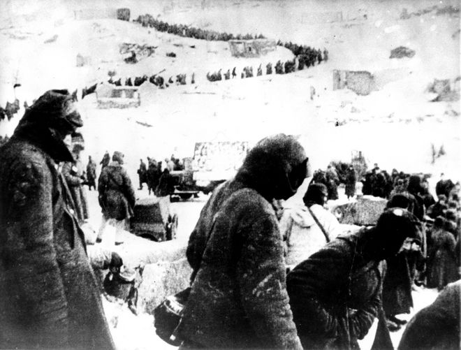 German prisoners of war captured by the Russians in the defense of Stalingrad march in a long line winding over a hill toward a Communist prison camp on March 26, 1943 during World War II.  (AP Photo)