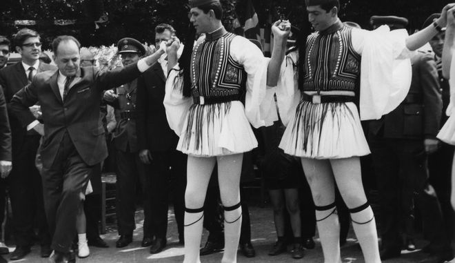 Greek Premier George (Georgios) Papadopoulos, left, dances with Evzonos Royalal Guards, a custom within the traditional Easter egg cracking ceremony during a visit to military units near Athens, Greece, April 9, 1972, on the occasion of Greek easter celebrations.  (AP Photo)