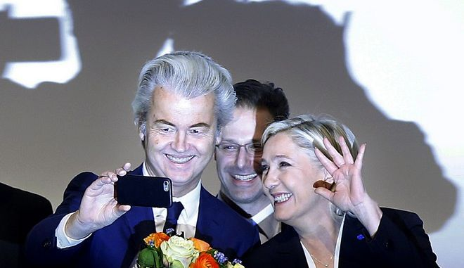 Far-right leader and candidate for next spring presidential elections Marine le Pen from France, right, and Dutch populist anti-Islam lawmaker Geert Wilders stand together after their speeches during a meeting of European Nationalists in Koblenz, Germany, Saturday, Jan. 21, 2017. (AP Photo/Michael Probst)