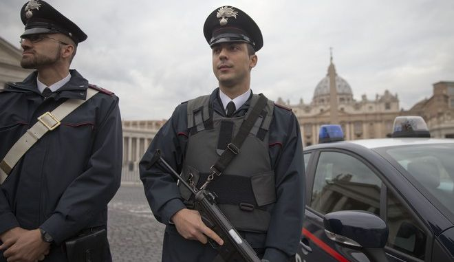 Italian Carabinieri officers patrol the area St' Peter's Square, at the Vatican, prior to the start of Pope's weekly general audience,  Wednesday, Nov. 18, 2015. (AP Photo/Andrew Medichini)