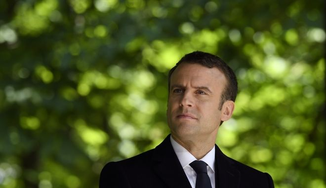 President-elect Emmanuel Macron attends a ceremony to mark the anniversary of the abolition of slavery  Wednesday May 10, 2017 in Paris. (Eric Feferberg, Pool via AP)