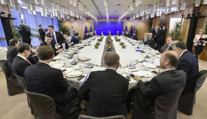 European Union heads of state attend a breakfast meeting at an EU summit in Brussels on Friday, Dec. 15, 2017. European Union leaders were set Friday to authorize a new phase in Brexit talks as time runs short to clinch an agreement on future relations and trade with Britain before it leaves the bloc in March 2019. (John Thys, Pool Photo via AP)