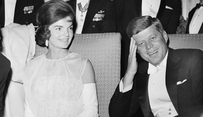 "FILE - In this Jan. 20, 1961 file photo, President John F. Kennedy and first lady Jacqueline Kennedy are seated as they attend one of five inaugural balls in Washington, DC. A new documentary, ""JFK: Fact and Fable,"" examines the role the late Jacqueline Kennedy Onassis played in shaping President John F. Kennedys public persona. (AP Photo, File)"