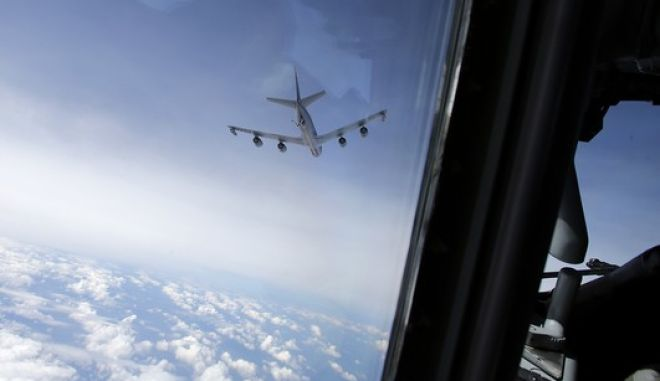 A U.S. KC135 tanker aircraft leaves after refueling a NATO E-3A Component AWACS aircraft during a patrol over Romania and Poland, Friday, April 18, 2014. NATO performs daily AWACs surveillance flights over Poland and Romania, part of stepped up efforts to monitor airspace along the border with Ukraine. (AP Photo/Frank Augstein)