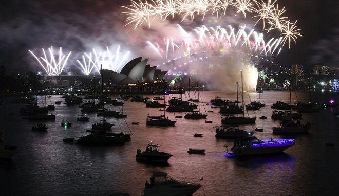 Fireworks explode over Sydney Harbour during New Year's Eve celebrations in Sydney, Monday, Jan. 1, 2018. (David Moir/AAP Image via AP)