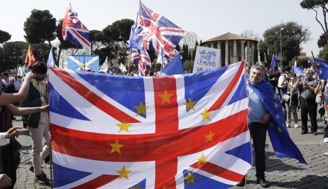 Members of the British In Italy group display the Union Jack flag as they prepare to take part into a demonstration in support of the European Union in Rome, Saturday, March 25, 2017, the day leaders of the European Union gathered in Rome to mark the 60th anniversary of the bloc.  (AP Photo/Gregorio Borgia)