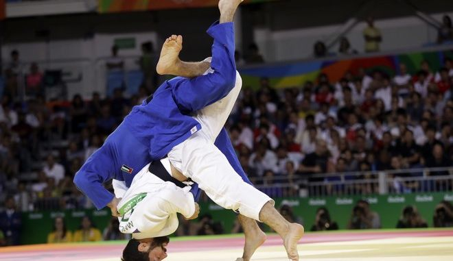 United Arab Emirates's Sergiu Toma, above, flips Italy's Matteo Marconcini during the men's 81 kg judo competition of the 2016 Summer Olympics in Rio de Janeiro, Brazil, Tuesday, Aug. 9, 2016. (AP Photo/Gregory Bull)