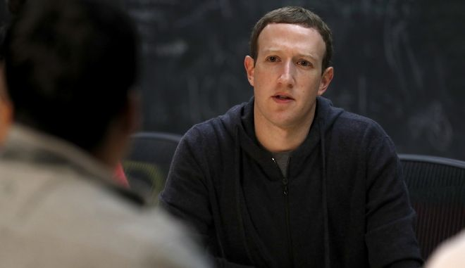 Facebook CEO Mark Zuckerberg meets with a group of entrepreneurs and innovators during a round-table discussion at Cortex Innovation Community technology hub Thursday, Nov. 9, 2017, in St. Louis. Zuckerberg was in St. Louis to announce a program to boost small businesses and bolster individual technical skills both on and off Facebook. (AP Photo/Jeff Roberson)