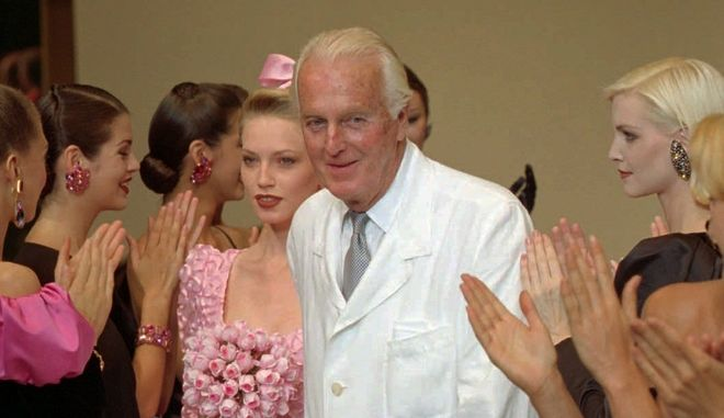 French designer Hubert de Givenchy is applauded by his models after his 1995-96 fall-winter haute couture fashion collection in Paris, Tuesday July 11, 1995. This was Givenchy's last show before he retires.(AP Photo/Lionel Cironneau)