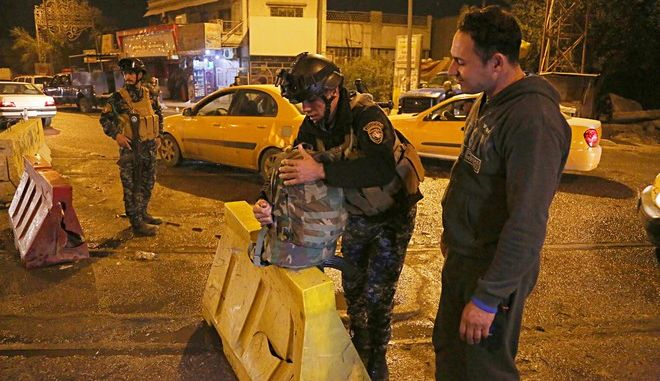 Iraqi security forces working at the scene of a suicide bombing in Baghdad, Iraq, Saturday, Jan. 13, 2018. Police and hospital officials say the Saturday blast struck a northern Baghdad neighborhood targeting a police checkpoint on a busy street, and that a number of policemen were among the wounded. (AP Photo/Karim Kadim)
