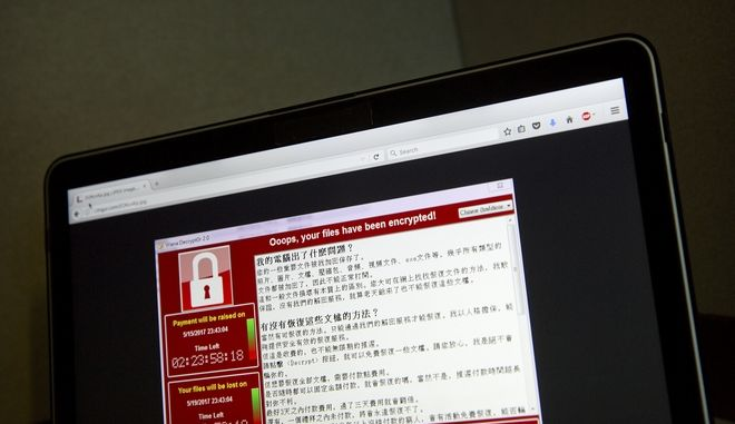 "FILE - In this May 13, 2017 file photo, a screenshot of the warning screen from a purported ransomware attack, as captured by a computer user in Taiwan, is seen on laptop in Beijing.  Global cyber chaos is spreading Monday, May 14,  as companies boot up computers at work following the weekend's worldwide ""ransomware"" cyberattack. The extortion scheme has created chaos in 150 countries and could wreak even greater havoc as more malicious variations appear. The initial attack, known as ""WannaCry,"" paralyzed computers running Britain's hospital network, Germany's national railway and scores of other companies and government agencies around the world.  (AP Photo/Mark Schiefelbein, File)"