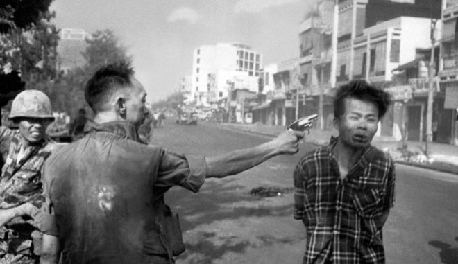FILE - In this Feb. 1, 1968, file photo, South Vietnamese Gen. Nguyen Ngoc Loan, chief of the National Police, fires his pistol into the head of suspected Viet Cong officer Nguyen Van Lem (also known as Bay Lop) on a Saigon street, early in the Tet Offensive. The photo showed the war's brutality in a way Americans hadn't seen before. Protesters saw it as graphic evidence that the U.S. was fighting on the side of an unjust government. (AP Photo/Eddie Adams, File)