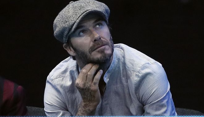 Former England footballer David Beckham watches Jamie Murray of Britain and Bruno Soares of Brazil play against Ivan Dodig of Croatia and Marcelo Melo of Brazil in their ATP World Tour Finals doubles tennis match at the O2 Arena in London, Thursday, Nov. 17, 2016. (AP Photo/Kirsty Wigglesworth)