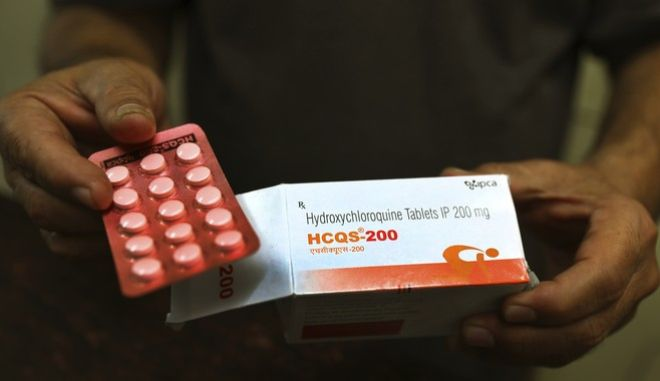 FILE - In this Thursday, April 9, 2020 file photo, a chemist displays hydroxychloroquine tablets in New Delhi, India. Scientists in Brazil have stopped part of a study of the malaria drug touted as a possible coronavirus treatment after heart rhythm problems developed in one-quarter of people given the higher of two doses being tested. Chloroquine and a similar drug, hydroxychloroquine, have been pushed by President Donald Trump after some early tests suggested the drugs might curb coronavirus entering cells.  (AP Photo/Manish Swarup, File)