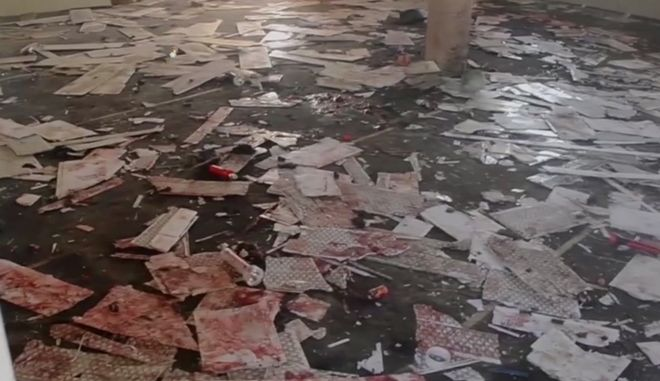 This image taken from TV, shows the interior of a mosque after a deadly attack by a suicide bomber, in Mubi, Adamawa State, Nigeria, Tuesday Nov. 21, 2017.  A teenage suicide bomber detonated as worshippers gathered for morning prayers at a mosque in northeastern Nigeria, killing at least 50 people, police said Tuesday, in one of the region's deadliest attacks in years. (AP Photo)