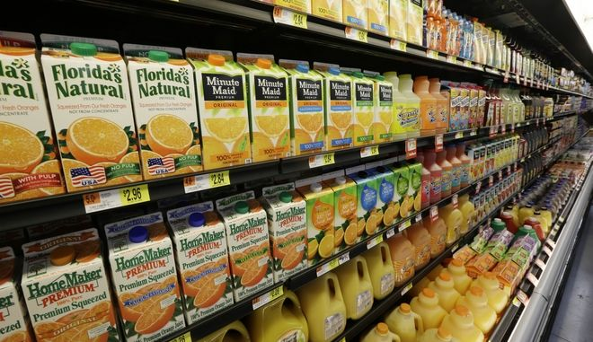 Orange Juice is displayed in a Bentonville, Ark., Wal-Mart Neighborhood Market Thursday, June 4, 2015. (AP Photo/Danny Johnston)