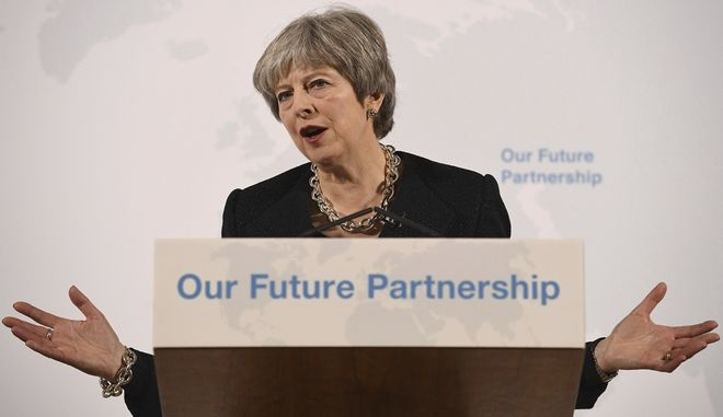 Britain's Prime Minister Theresa May delivers a speech at Mansion House, in London, Friday, March 2, 2018. May is promising to tell an impatient European Union on Friday what Britain is prepared to give and what it wants to take in a post-Brexit trade deal with the bloc.(Leon Neal/Pool Photo via AP)