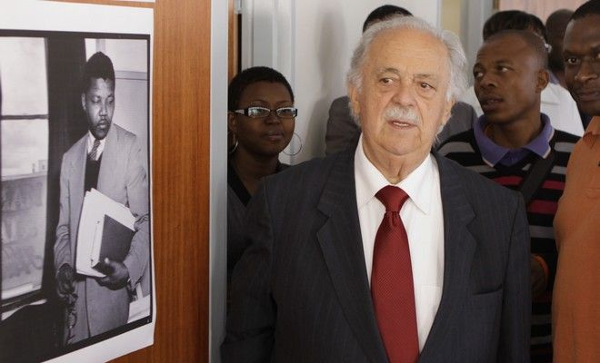 FILE - In this Wednesday May 4, 2011, file photo, Advocate George Bizos tours the building where Nelson Mandela and Oliver Tambo had a historic law office in Johannesburg. Bizos, a member of the legal team that defended Mandela and others at the Rivonia trial, said Machel invited him to see Mandela in the hospital last month. But the visit was canceled when the health of his old friend deteriorated. (AP Photo/Denis Farrell, File)