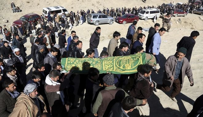 Men carry the coffin of a relative who died in Thursday's suicide attack on a Shiite cultural center in Kabul, Afghanistan, Friday, Dec. 29, 2017.  An Islamic State suicide bomber struck a Shiite cultural center in Kabul on Thursday, killing dozens of people and underscoring the extremist group's growing reach in Afghanistan even as its self-styled caliphate in Iraq and Syria has been dismantled. (AP Photo/Rahmat Gul)