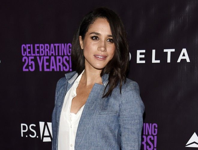 FILE - In this May 20, 2016. file photo, actress Meghan Markle poses at P.S. Arts'