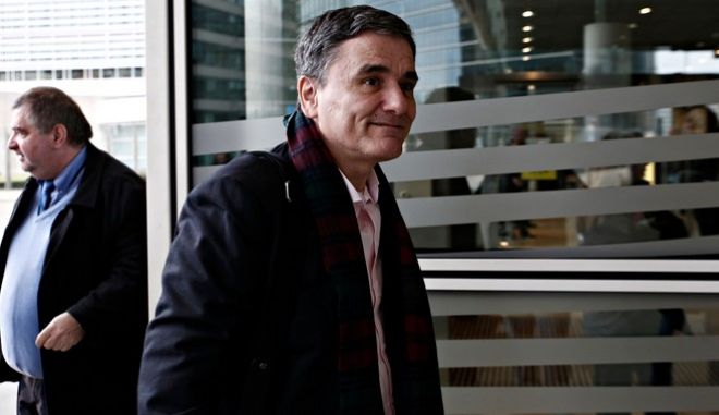 Greeces Finance Minister Euclid Tsakalotos meets the European Commissioner for Economic and Financial Affairs, Taxation and Customs Pierre Moscovici in Brussels, Belgium on Jan. 12, 2017.  /                      12 , 2017.