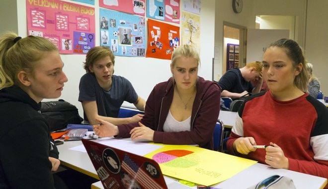 Students at the Borgarholtsskoli high school in Reykjavik attend a Gender Studies class on Friday, Dec. 1, 2017. The aim of the class is to get young adults to notice everyday discrimination, stereotyping and harmful messages. Iceland scores high on studies of gender equality but still has high rates of violence against women. (AP Photo/David Keyton)