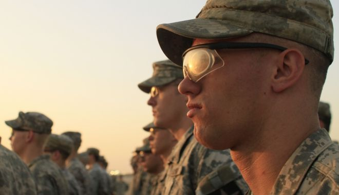 In this photo taken Saturday, Aug. 21, 2010, U.S. Army soldiers from 4th Battalion, 9th Infantry Regiment stand in formation during the casing ceremony for 4th Brigade, 2nd Infantry Division, the last American combat brigade to serve in Iraq, at Camp Virginia, Kuwait. The number of U.S. troops in Iraq has fallen below 50,000 for the first time since the 2003 U.S.-led invasion and ahead of the end-of-the-month deadline mandated by President Barack Obama, the American military said in a statement Tuesday. The number is a watershed _ American forces will no longer conduct combat operations in the country but are instead to train Iraqi troops and help with counter terrorism operations, if asked for by the Iraqis. (AP Photo/Maya Alleruzzo)