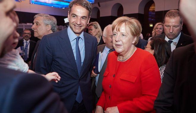 Ο Πρόεδρος της Νέας Δημοκρατίας, Κυριάκος Μητσοτάκης και η Γερμανίδα καγκελάριος Άνγκελα Μέρκελ στη συνάντηση της Κ.Ο. του EPP