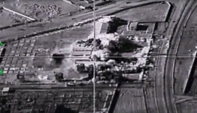 This photo provided by the Russian Defense Ministry Press Service shows an Islamic State group target in Syria hit by a Russian air strike on Tuesday, Jan. 24, 2017. The mission, the third such bombing raid in four days, targeted the Islamic State group around Deir el-Zour in eastern Syria where the Islamic State group has launched an offensive against Syrian government forces. (Russian Defense Ministry Press Service Photo via AP)