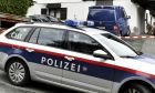 A police car is parked in front of a house in Kitzbuehl, Austria, Sunday, Oct. 6, 2019. Austrian police say a 25-year-old man's in custody after allegedly killing his ex-girlfriend, her family, and her new boyfriend in the Alpine resort town of Kitzbuehel. The 25-year-old turned himself to police in the town east of Innsbruck and admitted to the five slayings early Sunday morning, Austrian news agency APA reported. (AP Photo/Kerstin Joensson)