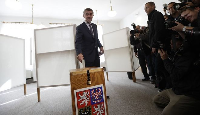 Czech billionaire and leader of the ANO 2011 political movement Andrej Babis casts his vote during the parliamentary elections in Pruhonice, Czech Republic, Friday, Oct. 20, 2017. Czechs are voting in a parliamentary election whose result could see yet another euro-skeptic government on the continent. Two hundred seats are up for grab in the lower house of Parliament in the two-day ballot that began on Friday. (AP Photo/Petr David Josek)