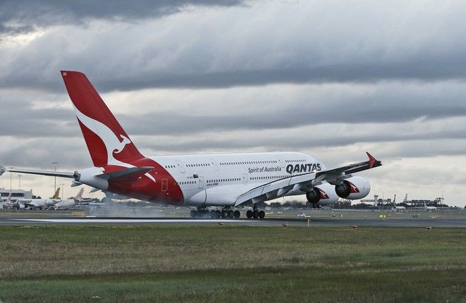 A Qantas A380 lands at Sydney International Airport in Sydney, Australia, Tuesday, Sept. 13, 2016. The airline has 12, A380 Airbus aircraft in its fleet flying to Los Angeles, Hong Kong, Dubai and London. (AP Photo/Rob Griffith)