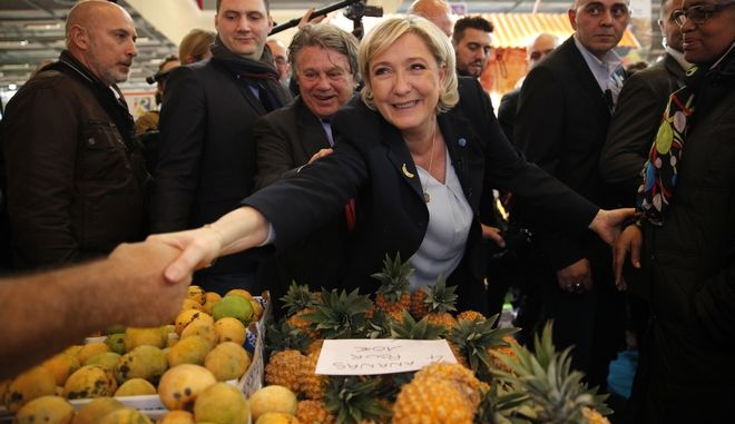 French far-right leader Marine le Pen shakes hands with farmers at the French Caribbean islands stand as she visits the Agriculture Fair Tuesday, Feb. 28, 2017 in Paris. Le Pen is among a parade of candidates for the April-May election visiting the huge annual Paris agricultural fair this week. (AP Photo/Christophe Ena)