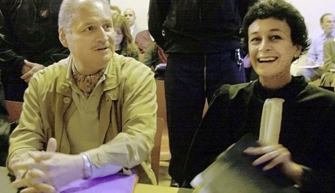FILE - In this Tuesday, Nov. 28, 2000 file photo, Venezuelan international terrorist Carlos the Jackal whose real name is Ilich Ramirez Sanchez, left, sits with his French lawyer Isabelle Coutant-Peyre in a Paris courtroom. Coutant-Peyre confirmed Friday Oct. 12, 2001 she will marry Ramirez Sanchez. Once among the world's most feared masterminds of terror, the man known as Carlos the Jackal is now a greying convict serving out a life sentence that may get longer after he meets his judges in a new trial over the deaths of 11 people in four attacks on French soil nearly three decades ago. (AP Photo/Michel Lipchitz, File)