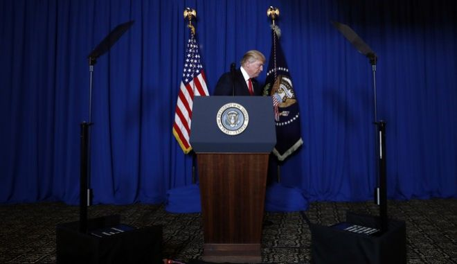 In this April 6, 2017, photo, President Donald Trump walks from the podium after speaking at Mar-a-Lago in Palm Beach, Fla., Thursday, April 6, 2017, after the U.S. fired a barrage of cruise missiles into Syria. Trumps White House, one perpetually plagued by infighting among aides jockeying for the presidents ear, has been sharply divided by a new rivalry, one pitting his powerful son-in-law with unfettered access to the president against the sharp-elbowed ideologue who fueled Trumps populist campaign rhetoric. (AP Photo/Alex Brandon)