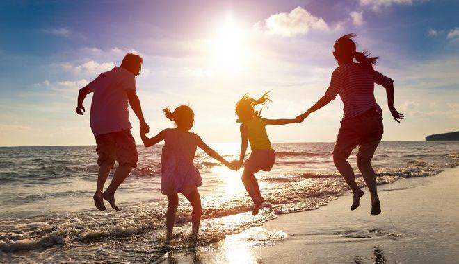 Οικογένεια στην παραλία