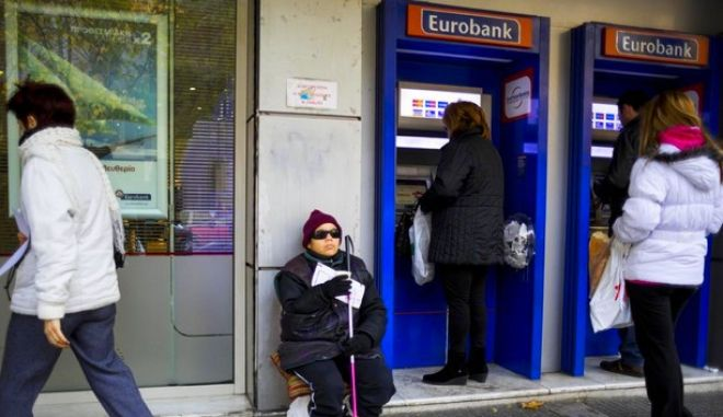 Blind woman begs outside of Eurobank branch in northern Greece city of Thessaloniki./        Eurobank       .