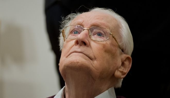 Former SS guard Oskar Groening waits for the start of the trail against him in a courtroom in Lueneburg, northern Germany, Thursday, April 23, 2015. Groening, 93, is accused of helping to operate the death camp Auschwitz in Nazi-occupied Poland between May and June 1944, when some 425,000 Jews from Hungary were brought there and at least 300,000 were almost immediately gassed to death. (Julian Stratenschulte/Pool Photo via AP)