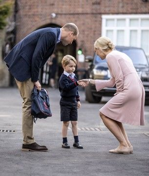 Britain's Prince William accompanies Prince George as he is greeted by Helen Haslem - the head of the lower school as he arrives for his first day of school at Thomas's school in Battersea, London, Thursday, Sept. 7, 2017.  Prince William's pregnant wife Kate was too ill with morning sickness Thursday to take young Prince George to his first day of school.  (Richard Pohle/Pool Photo via AP)