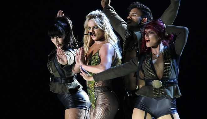 Famed U.S. singer Britney Spears sings during her concert in Taipei, Taiwan, Tuesday, June 13, 2017. (AP Photo/Chiang Ying-ying)
