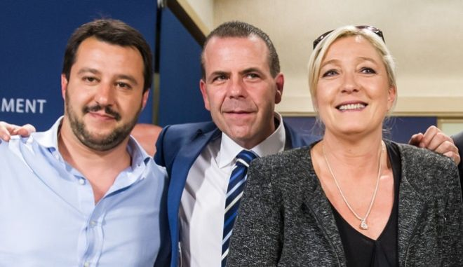 French far-right National Front party leader Marine Le Pen, right, poses for photographers with Austria's Secretary General of the Freedom Party FPOE Harald Vilimsky, center, and Federal Secretary of Italy's Lega Nord Matteo Salvini after a meeting with EU far-right parties at the European Parliament in Brussels, Wednesday May 28, 2014. Marine Le Pen, the French shock winner in the European elections, has come to the home of the European Union, the organization she blames for undermining France's economy, hamstringing its sovereignty and flooding it with immigrants. The National Front leader was searching Wednesday for enough like-minded fellow members of the European Parliament to form a parliamentary group, a step that would guarantee it more speaking time and allow it to benefit from administrative and financial support. Le Pens party came out on top in Sundays elections, and will be sending Frances largest contingent to the European Parliament. (AP Photo/Geert Vanden Wijngaert)
