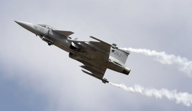 Gripen, a Swedish fighter aircraft performs at the opening ceremony of Aero India 2017 at Yelahanka air base in Bangalore, India, Tuesday, Feb. 14, 2017. Aero India is a biennial event with flying demonstrations by stunt teams and militaries and commercial pavilions where aviation companies display their products and technology. The five-day event ends Saturday. (AP Photo/Aijaz Rahi)