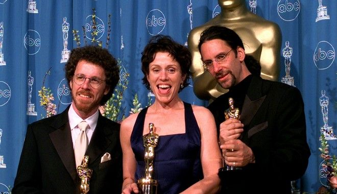 Best Actress winner Frances McDormand poses between her husband Joel Coen, right, and Ethan Coen at the 69th annual Academy Awards in Los Angeles Monday, March 24, 1997. McDormand won for