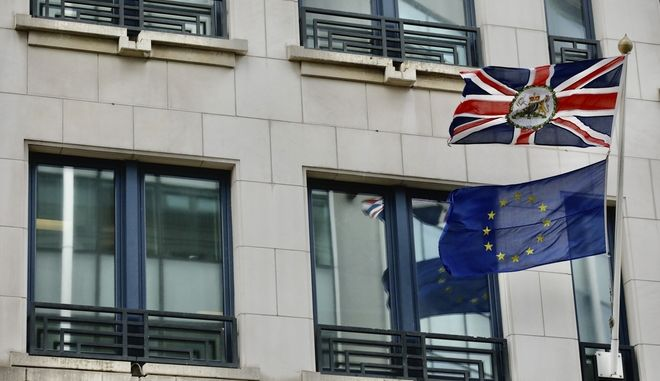The Union and EU flags flap in the wind in front of the UK Permanent Representation to the EU in Brussels, Friday, Jan. 31, 2020. The U.K. is due to leave the EU on Friday the first nation in the bloc to do so. (AP Photo/Olivier Matthys)