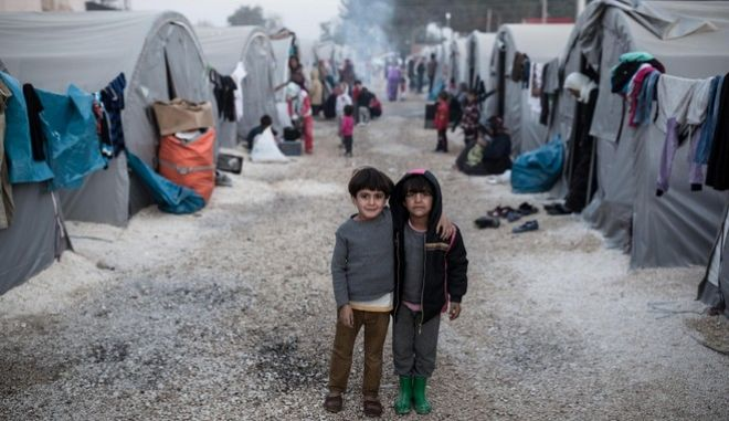 Syrian Kurds from Kobane in the 'Rojava' refugee camp in the border town of Suruc, Sanliurfa province on November 10, 2014.