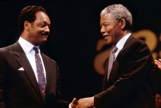 Nelson Mandela shakes hands with Rev. Jesse Jackson, Sr. in this 1990 photo.  (Frederick Watkins, Jr./Ebony Collection)