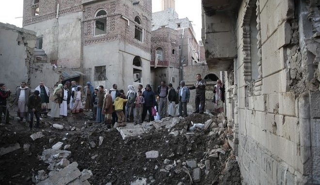 People gather at the site of a Saudi-led airstrike near Yemen's Defense Ministry complex in Sanaa, Yemen, Saturday, Nov. 11, 2017. (AP Photo/Hani Mohammed)
